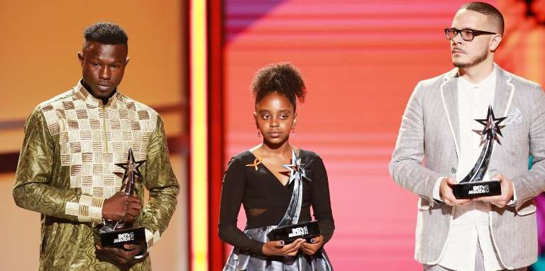 LOS ANGELES, CA - JUNE 24: (L-R) Mamadou Gassama, Naomi Wadler and Shaun King are honored onstage at the 2018 BET Awards at Microsoft Theater on June 24, 2018 in Los Angeles, California.   Leon Bennett/Getty Images/AFP
